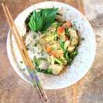 Thai Green Curry in ceramic bowl with chopsticks. #greencurry #curry #asianfood #thaifood #chickencurry @flippedoutfood