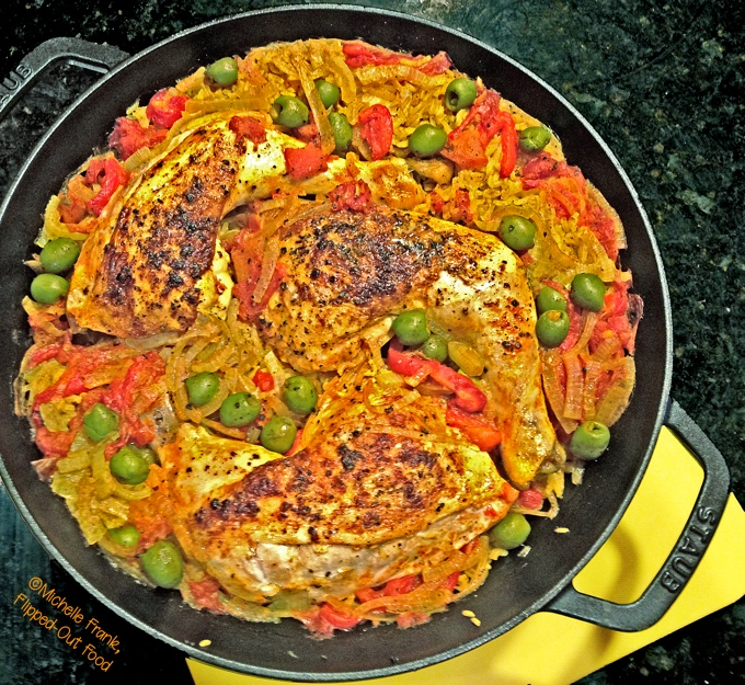 one-pan arroz con pollo in skillet, fresh from the oven.