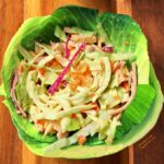 Top view of Easy, Zippy Coleslaw in a bowl made of cabbage leaves.