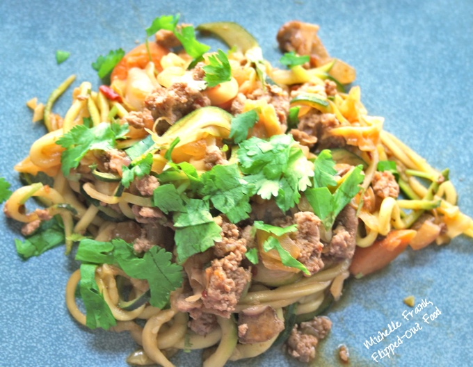 Vegetable-Turkey Lo Mein with Zoodles: an individual serving scattered with cilantro, presented on a blue plate.