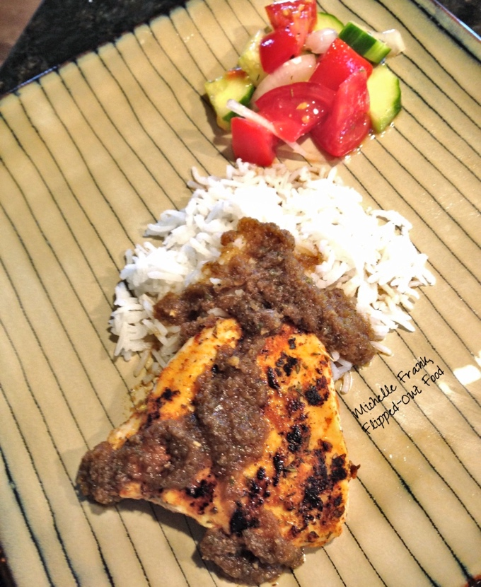 Angry Jerk Sauce recipe: jerk chicken served with coconut rice and a mixed salad of cucumber, tomato, and onion. #caribbeanfood #jamaicanfood #spicyfood #jerksauce #jerkchicken @FlippedOutFood