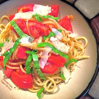 Tomato-Basil Pasta serving in a bowl. A healthy meal that makes your garden (or Farmer's Market) tomatoes shine! #pasta #healthyfood #tomatobasilpasta #healthyeating #quickmeal @FlippedOutFood