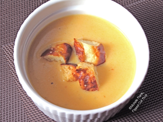Beer Cheese Soup with Pretzel Croutons in a single-serving ramekin. A delicious, creamy decadent soup your family will love! #comfortfood #cheesesoup #beercheesesoup @FlippedOutFood