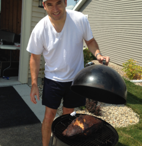 Phil, smoking a pork butt.