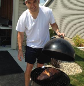 Phil, smoking a pork butt.