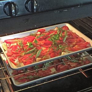 Slow-roasted tomato sauce: sliced tomatoes in pans, roasting in the oven with herbs, salt and pepper, garlic, and olive oil. #italianfood #marinarasauce #gardentomatosauce #tomatosauce #flippedoutfood #pastasauce via @FlippedOutFood