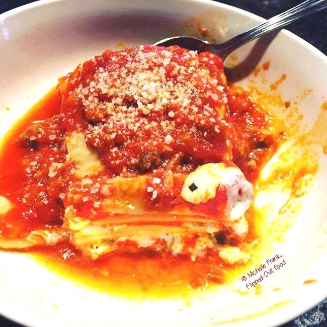 lasagna bolognese serving in a bowl
