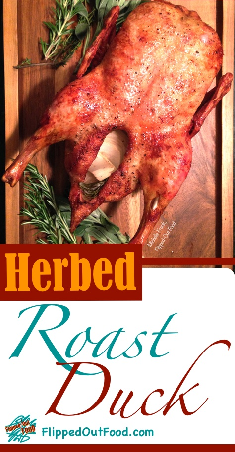 Herbed Roast Duck is perfect for holiday dinner parties. Perfumed with herbs and served with a tangy, aromatics-infused sauce.