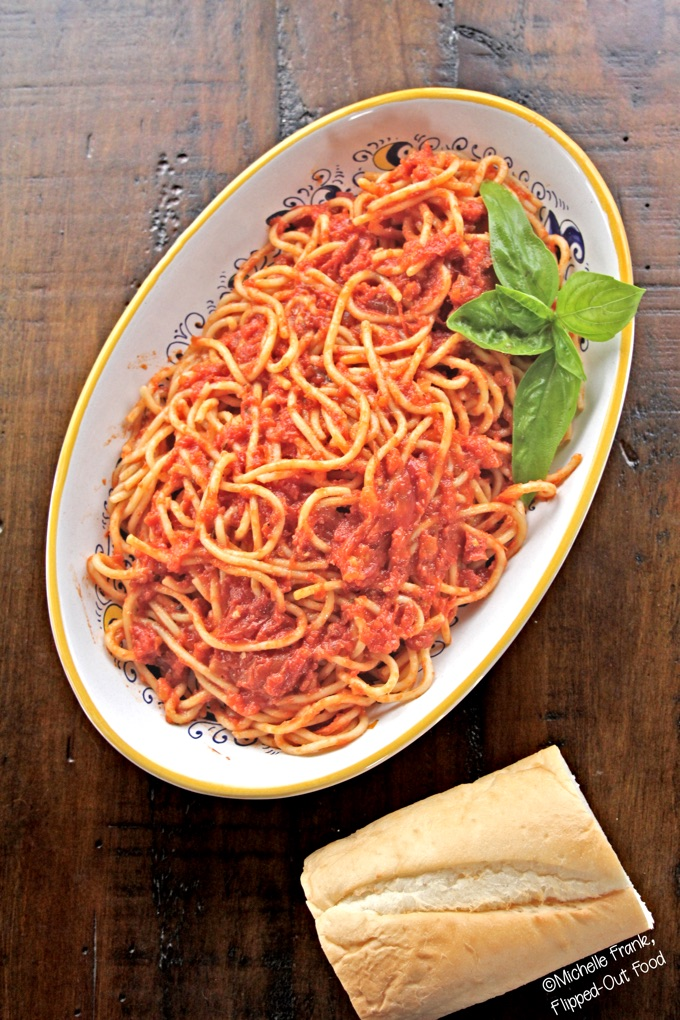 Slow-roasted tomato sauce: served with spaghetti and a hunk of bread. #italianfood #marinarasauce #gardentomatosauce #tomatosauce #flippedoutfood #pastasauce via @FlippedOutFood