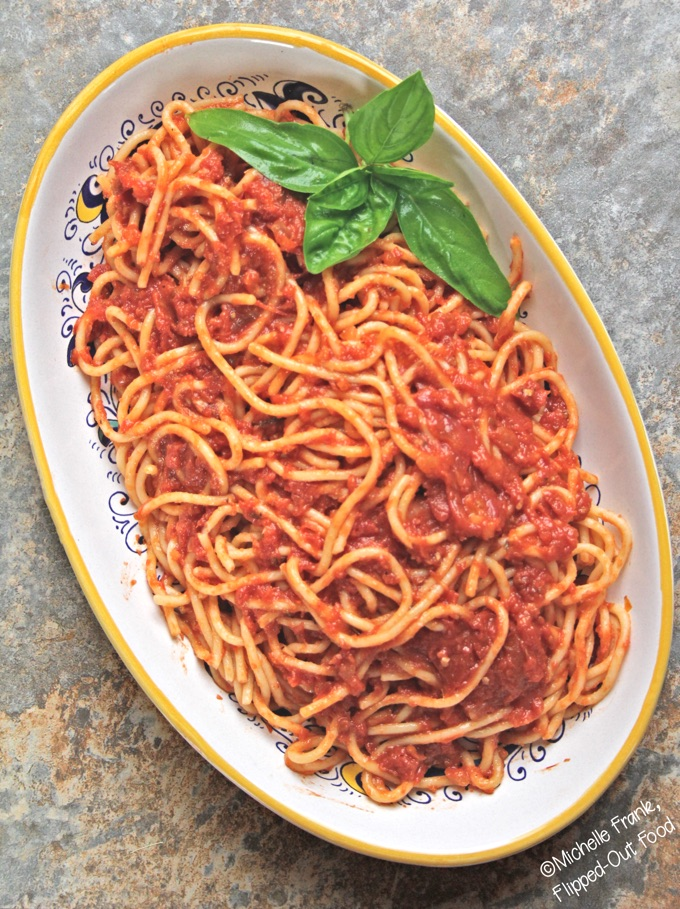 Slow-roasted tomato sauce: served with spaghetti. #italianfood #marinarasauce #gardentomatosauce #tomatosauce #flippedoutfood #pastasauce via @FlippedOutFood