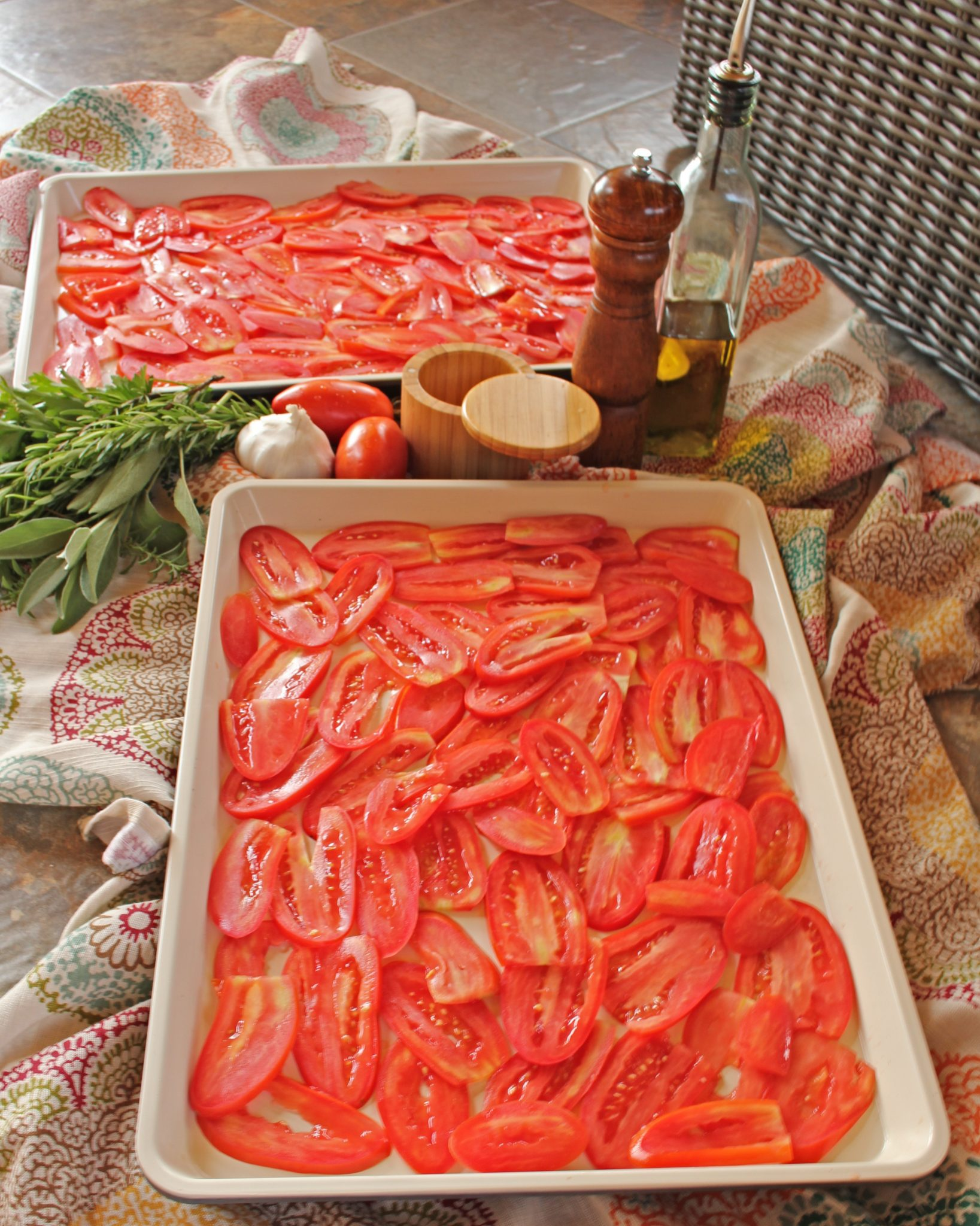 Slow-roasted tomato sauce: sliced tomatoes in pans, ready to go into the oven with herbs, salt and pepper, garlic, and olive oil. #italianfood #marinarasauce #gardentomatosauce #tomatosauce #flippedoutfood #pastasauce via @FlippedOutFood