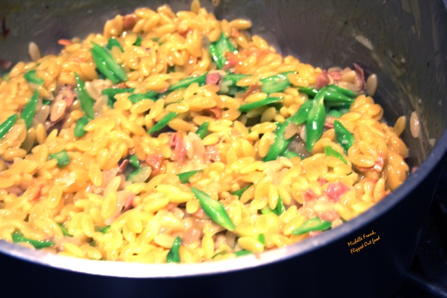 Asparagus orzotto with pancetta, nearly done in the Dutch oven