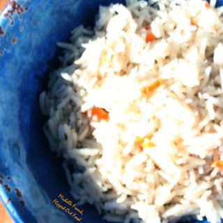 coconut-habanero rice in pretty blue bowl