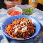 enchilada bowls with sweet potato noodles and fixings in the background