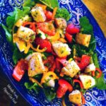 garlic scape vinaigrette on a salad of lettuce, tomatoes, sliced sweet peppers, and homemade croutons. #saladdressing #vinaigrette #garlicscapes #healthyeating @FlippedOutFood