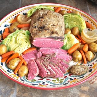A platter of make-ahead corned beef and cabbage with a dollop of grainy mustard #irishfood #cornedbeef #cornedbeefandcabbage #saintpatricksday #comfortfood #crockpot #slowcooker