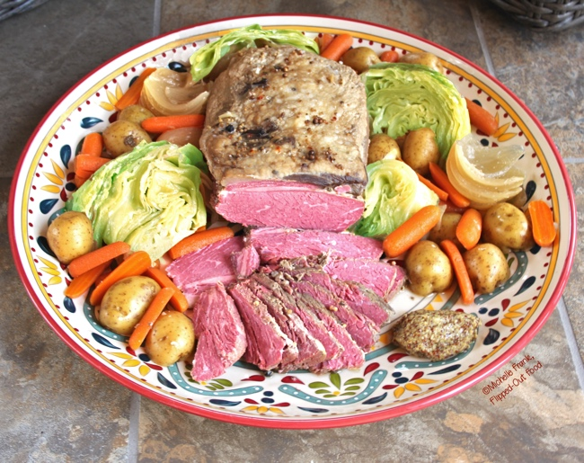 A platter of make-ahead crockpot corned beef & cabbage with a dollop of grainy mustard #irishfood #cornedbeef #cornedbeefandcabbage #saintpatricksday #comfortfood #crockpot #slowcooker