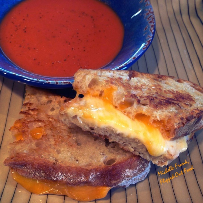 Grilled cheese sandwiches served with tomato soup