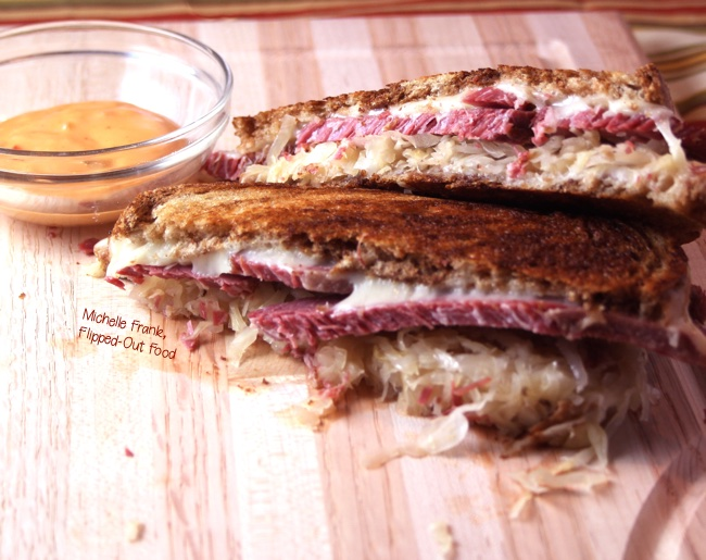 closeup of reuben sandwich on cutting board