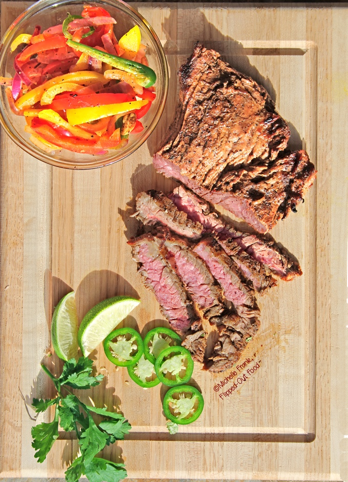 Carne Asada in Mojo Marinade is easy enough for a weeknight meal when you marinate the meat and meal-prep the vegetables in advance. #mexicanfood #carneasada #mealprep #flippedoutfood #healthyeating via @FlippedOutFood