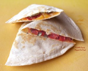Serving fajita quesadillas