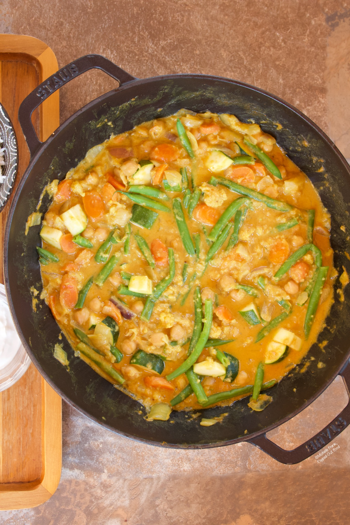 Easy Red Vegetable Curry in a cast-iron wok.