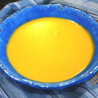 ginger-turmeric butternut squash soup in blue bowl. A delicious, healthy soup loaded with superfood super powers.