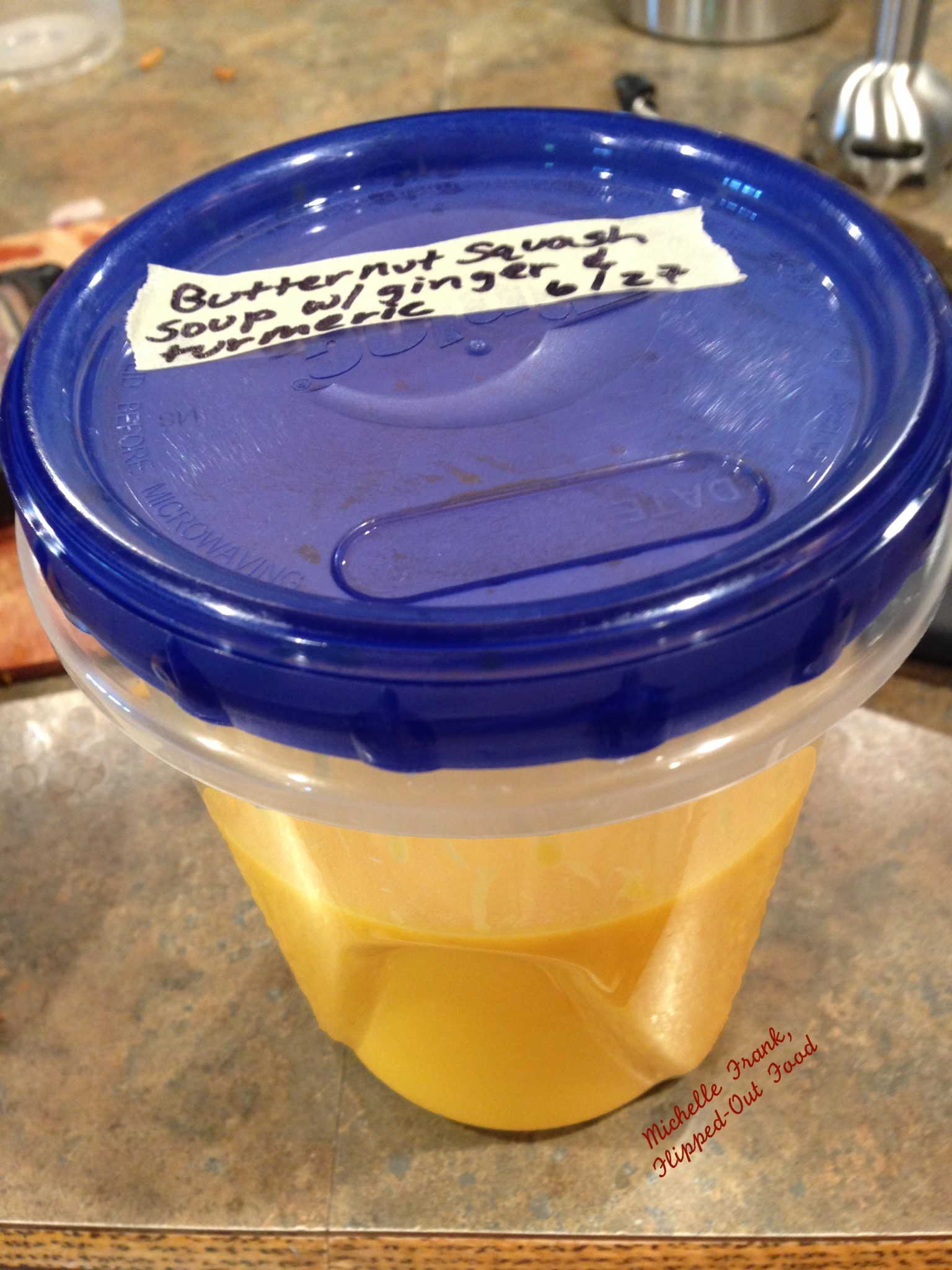 freezer container of ginger-turmeric butternut squash soup