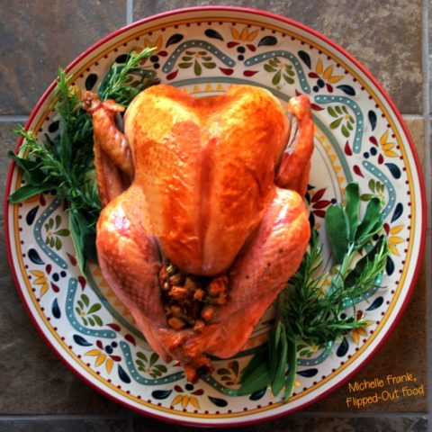 ultimate classic roast turkey on a platter with herbs