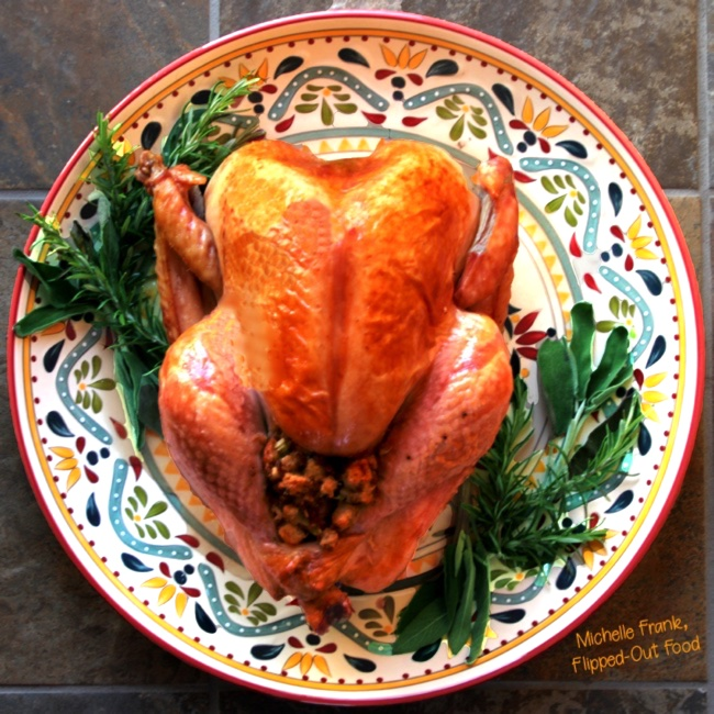 ultimate classic roast turkey with stuffing on a decorative platter with fresh herbs.