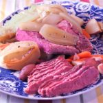 Corned beef and cabbage on serving platter with carrots and onions