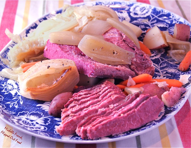 Corned beef & cabbage on serving platter with carrots and onions