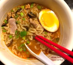 pork-miso ramen soup with soy-marinated egg in white bowl with leftover pork loin