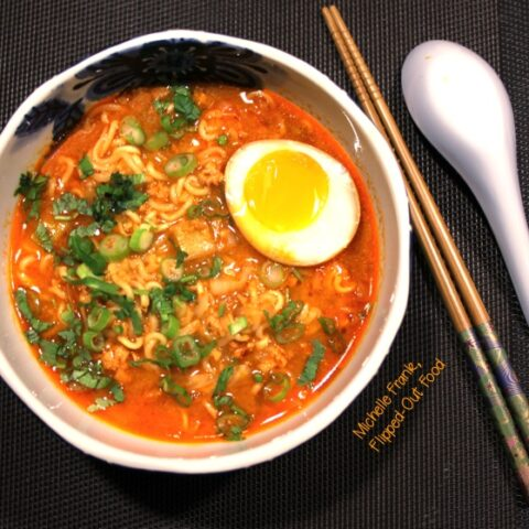 pork-miso ramen soup with soy-marinated egg top view. This is the soup that all ramen noodles want to be when they grow up! #ramennoodles #ramennoodlesoup #asianfood @FlippedOutFood