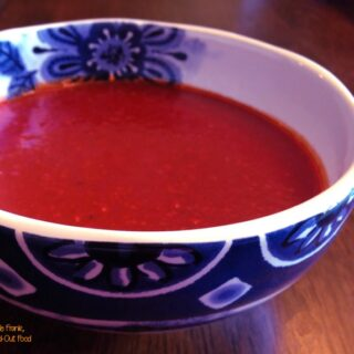 red enchilada sauce in a blue and white bowl