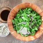 arugula-shaved fennel salad in wooden bowl