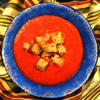 roasted tomato soup & homemade croutons served in a blue bowl