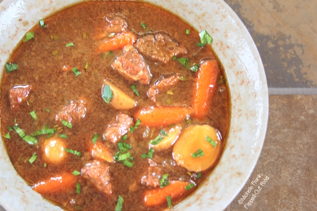 A close-up of a bowlful of Make-Ahead Irish Guinness Stew. This would be delightful served over mashed potatoes or colcannon, or simply with a chunk of crusty bread. Irish food | Guinness Stew | Comfort food | stew