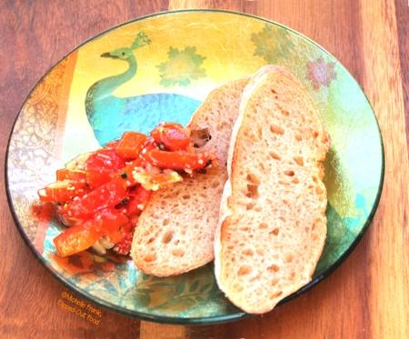 roast garlic red pepper bruschetta on a decorative plate, side view