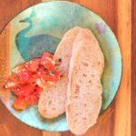 Roast Garlic-Sweet-Pepper Bruschetta on decorative plate, top view