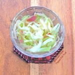 Piquant Cabbage-Onion-Bacon Sauté in a clear ramekin. A perfect side dish not only for pork chops, but for any roasted meat. #sidedish #sauteedcabbage #healthyfood