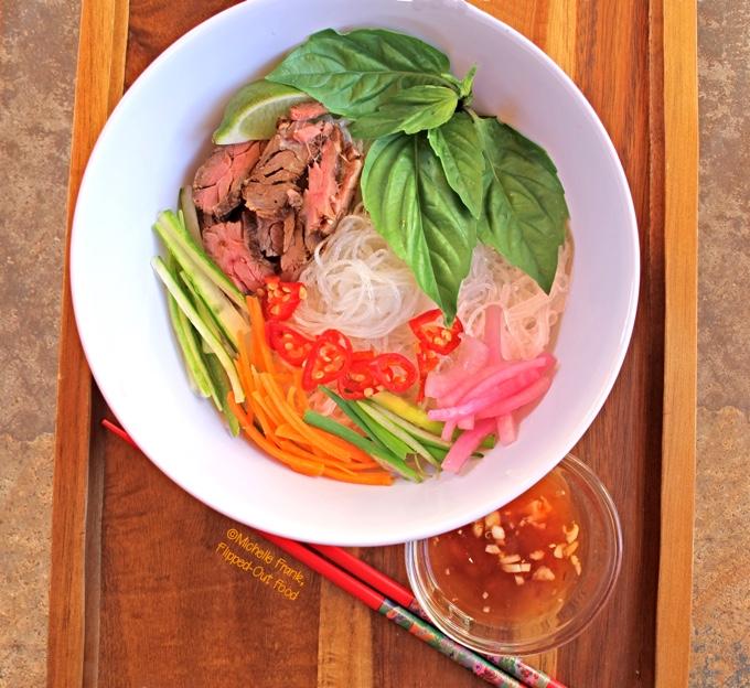 Bun Bo Xao: Vietnamese Lemongrass Beef Noodle Bowls: loaded bowl with chopsticks and nuoc cham. #vietnamesefood #bun #bunboxao #steak #lemongrass #ricenoodles @FlippedOutFood