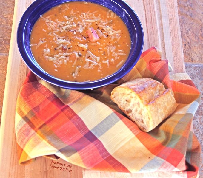 Crockpot Ham Split-Pea Soup is an easy, hearty weeknight meal. Shown here with a hunk of crusty bread. #crockpot #slowcooker #splitpeasoup #comfortfood #healthyeating #slowcooker #flippedoutfood @FlippedOutFood