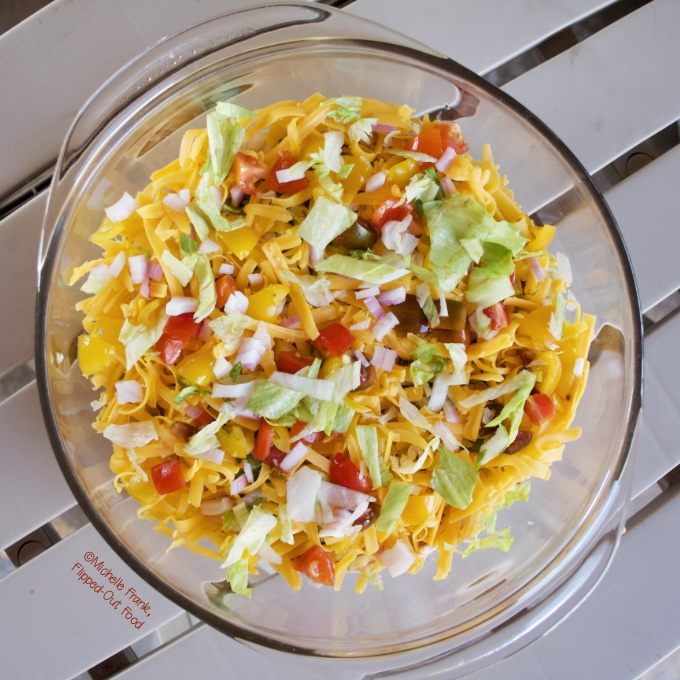 One of our favorite potluck recipes for July 4th: Taco Dip (Phil's Phamous) in a pyrex serving container.