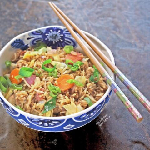 Leftover vegetable fried rice: side view. Fried rice is great way to clear out the refrigerator: use up your leftover rice, extra veggies, and even leftover cooked meat. #leftovers #friedrice #asianfood #flippedoutfood #frugalliving #budgetfriendlymeal