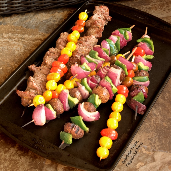 Marinated Vegetable Beef Kebabs on a baking sheet.