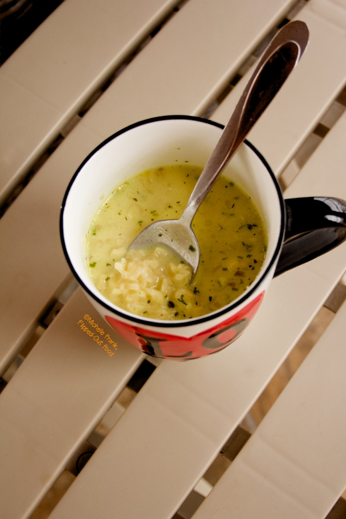 Pantry Creamy Chicken Ramen Soup in a large mug sitting atop a beige table.
