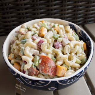 Creamy Pasta Salad in a blue and white bowl.