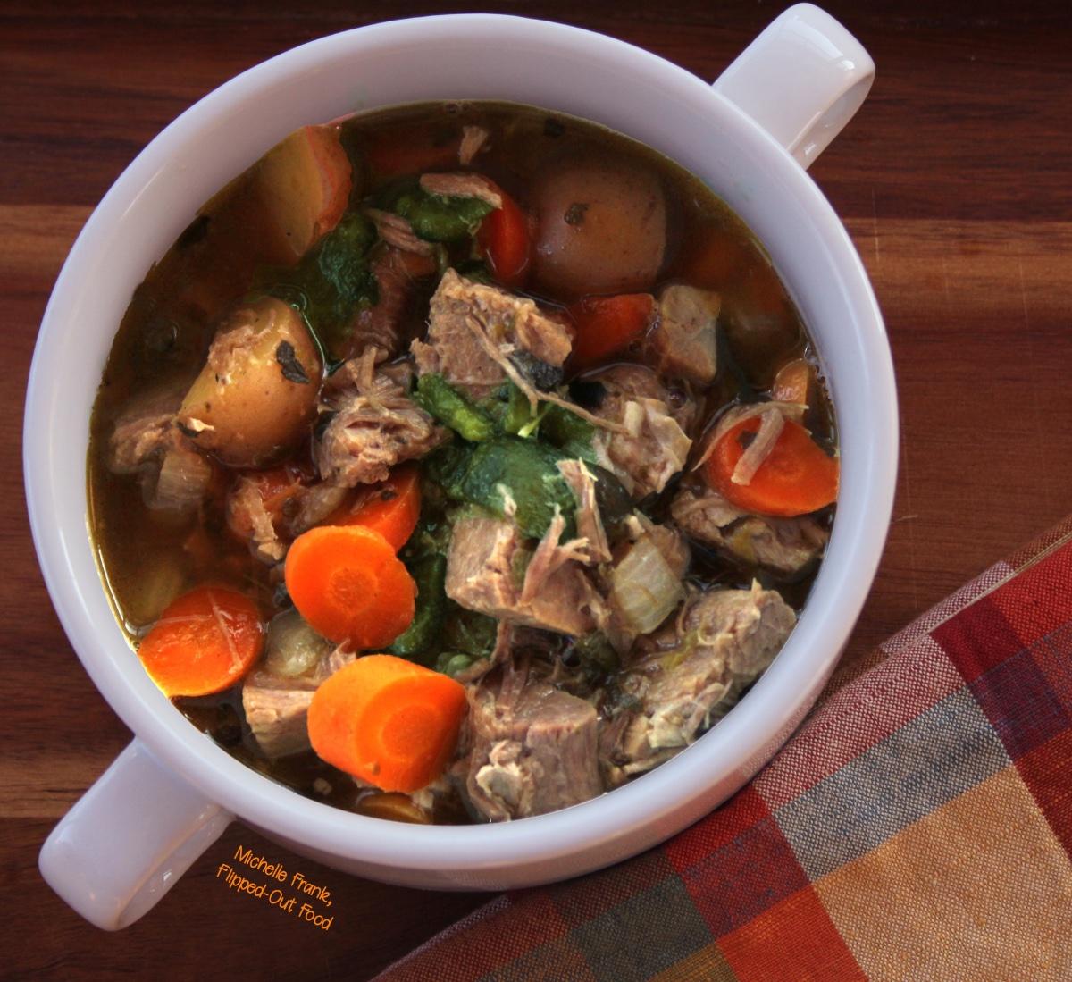 Caldillo: Green Chile Pork Stew in a 2-handled bowl.