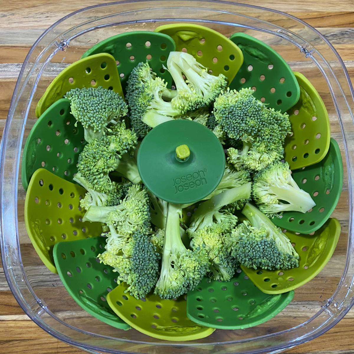 Broccoli florets in a do-it-yourself microwave steamer.